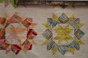 picture of a swoon quilt quiltled with modern quilting designs