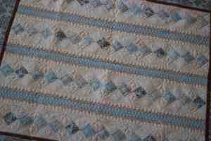 baby boy quilt with free-motion quilting