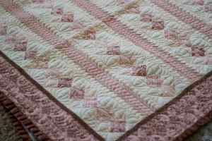 Baby girl quilt with free-motion quilting