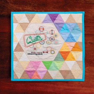 quilted embroidery quilt, machine quilting