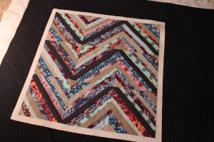 string quilt with modern machine quilting- longarm