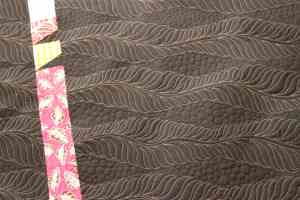 back of bamboo quilt- longarm feathers