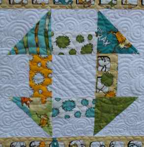Churn dash block with longarm quilting