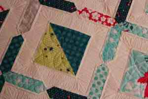 close up quilting of fat quarterly quilting
