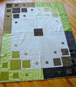 machine quilting on a quilt made of solids