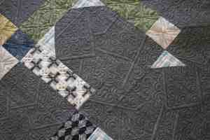 Close up of modern machine quilting designs