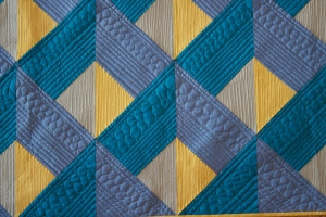 close up of modern quilting