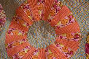 close up of quilting cartwheel quilt
